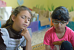 Children close their eyes and relax during an activity at the Youth Empowerment Center in Beit Hanoun, Gaza. The program is supported by Caritas and DanChurchAid, a member of the ACT Alliance, and is designed to help children better cope with the trauma they experienced during the 2014 war.<br /> <br /> In the wake of that war between the government of Gaza and the government of Israel, ACT Alliance members are supporting health care, vocational training, rehabilitation of housing and water systems, psycho-social care, and other humanitarian actions throughout the besieged Palestinian territory.