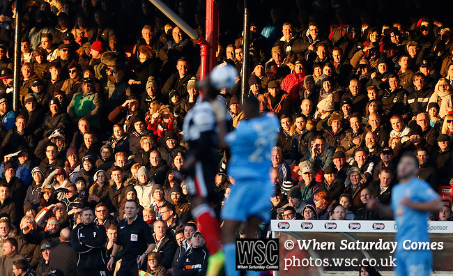 Grimsby Town 1 Lincoln City 3, 28/12/2014. Blundell Park, Football Conference. Fans in the Main Stand.  Photo by Paul Thompson.