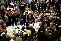Papa Francesco parla al suo arrivo in Aula Paolo VI in Vaticano. 19 novembre 2017.<br /> Sua Santit&agrave; ha offerto un pranzo ai bisognosi (senzatetto, migranti, disoccupati) dopo aver celebrato una Messa in occasione della prima Giornata Mondiale dei Poveri.<br /> Pope Francis speaks as he arrives for a lunch in Paul VI Hall  at the Vatican on Sunday, November 19, 2017. <br /> Pope Francis is offering several hundred poor people (homeless, migrants, unemployed) a lunch after celebrating a special mass to mark the new World Day of the Poor.<br /> UPDATE IMAGES PRESS/Isabella Bonotto<br /> <br /> STRICTLY ONLY FOR EDITORIAL USE