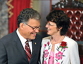 Washington, DC - July 7, 2009 -- United States Senator Al Franken (Democrat of Minnesota) shares a thought with his wife, Franni, as they await the arrival of Vice President Joseph Biden to participate in a mock swearing-in ceremony in the Old Senate Chamber in the U.S. Capitol in Washington, D.C. on Tuesday, July 7, 2009.  .Credit: Ron Sachs / CNP