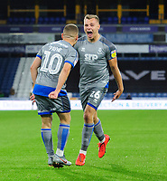 Lincoln City's Harry Anderson, right, celebrates scoring the opening goal with team-mate Jack Payne<br /> <br /> Photographer Chris Vaughan/CameraSport<br /> <br /> The Carabao Cup First Round - Huddersfield Town v Lincoln City - Tuesday 13th August 2019 - John Smith's Stadium - Huddersfield<br />  <br /> World Copyright © 2019 CameraSport. All rights reserved. 43 Linden Ave. Countesthorpe. Leicester. England. LE8 5PG - Tel: +44 (0) 116 277 4147 - admin@camerasport.com - www.camerasport.com