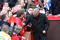 Pictured: Sir Alex Ferguson sign autographs. Sunday 12 May 2013<br /> Re: Barclay's Premier League, Manchester City FC v Swansea City FC at the Old Trafford Stadium, Manchester.
