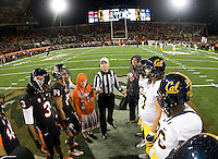 California and Oregon captains watch referee Jay Stricherz tosses the coin before the game at Reser Stadium in Corvallis, Oregon on November 17th, 2012.  Oregon State defeated California, 62-14.