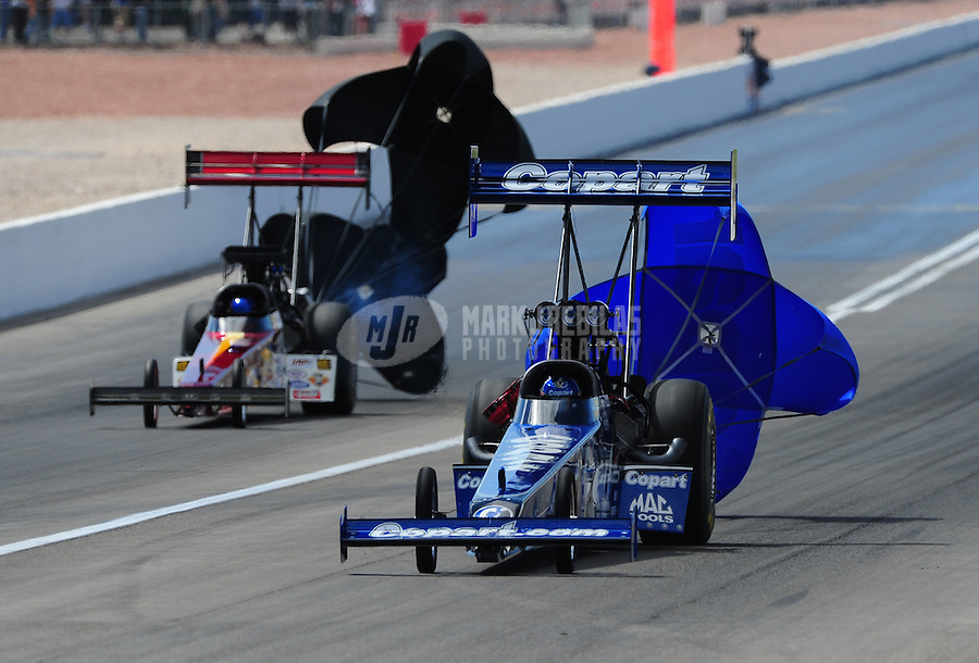 Apr. 3, 2011; Las Vegas, NV, USA: NHRA top fuel dragster driver Brandon Bernstein (right) defeats Steve Faria during the Summitracing.com Nationals at The Strip in Las Vegas. Mandatory Credit: Mark J. Rebilas-