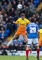 Danny Rowe of Wycombe Wanderers wins the ball in the air during the Sky Bet League 2 match between Portsmouth and Wycombe Wanderers at Fratton Park, Portsmouth, England on 23 April 2016. Photo by Andy Rowland.