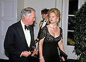 Robert A. Day, Chairman, Trust Company of the West and Kelly Gilmore arrive at the White House in Washington, DC for the State Dinner honoring President Carlos Menem of Argentina on Thursday, November 14, 1991.<br /> Credit: Ron Sachs / CNP