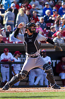 Quad Cities River Bandits catcher Jake Rogers (4) throws down to secon base between innings of a Midwest League game against the Wisconsin Timber Rattlers on April 8, 2017 at Fox Cities Stadium in Appleton, Wisconsin.  Wisconsin defeated Quad Cities 3-2. (Brad Krause/Four Seam Images)
