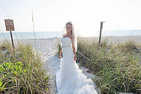 Ashley Hoffner, Miss Fort Meyers USA and a recent graduate of FGCU, poses in a wedding gown from Loretta Bridal Boutique in Bonita Springs on the beach along Gulf of Mexico near the historic Naples Fishing Pier, Naples, Florida, May 8, 2012, photo by Debi Pittman Wilkey/News-Press.com.