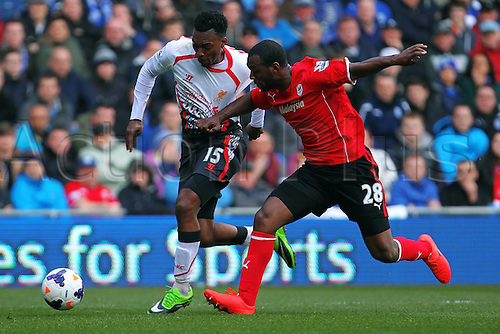22.03.2014  Cardiff, Wales. Daniel Sturridge of Liverpool and Kevin Theophile-Catherine of Cardiff City  in action during the Premier League game between Cardiff City and Liverpool from Cardiff City Stadium.