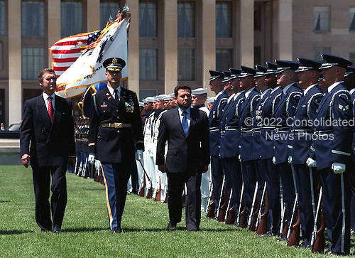 His Majesty King Abdullah II, (right), of the Hashemite Kingdom of Jordan, inspects the joint services honor guard as he is welcomed to the Pentagon on May 20, 1999, by United States Secretary of Defense William Cohen (left) with a military full honor arrival ceremony.  The king and Cohen are escorted by Commander of Troops Lieutenant Colonel Mark Armstrong (center), U.S. Army.  .Mandatory Credit: Robert D. Ward / DoD via CNP.