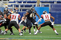 24 September 2011:  FIU defensive tackle Curtis Bryant (61) prepares to block ULL linebacker Devon Lewis-Buchanan (11) in the first quarter as the University of Louisiana-Lafayette Ragin Cajuns defeated the FIU Golden Panthers, 36-31, at FIU Stadium in Miami, Florida.