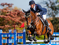 Park Trader, with rider Buck Davidson (USA), competes during the Stadium Jumping test during the Fair Hill International at Fair Hill Natural Resources Area in Fair Hill, Maryland on October 21, 2012.