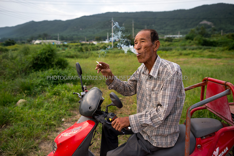 9/10/13 -- Cheongsando Island, Jeonnam Province (Jeollanam-do), South Korea<br /> <br /> A farmer enjoys a cigarette after a long days work.<br /> <br /> Photograph by Stuart Isett<br /> &copy;2013 Stuart Isett. All rights reserved.