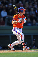 Clemson Tigers first baseman Jon McGibbon #12 swings at a pitch during a game against the South Carolina Gamecocks at Fluor Field on March 1, 2014 in Greenville, South Carolina. The Gamecocks defeated the Tigers 10-2. (Tony Farlow/Four Seam Images)