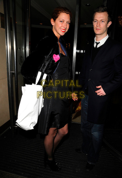MARGOT STILLEY.The Julien McDonald LFW catwalk show, Hilton Park Lane hotel, London, England..February 15th, 2008.fashion week full length black fur jacket coat goody bags margo stilly .CAP/CAN.©Can Nguyen/Capital Pictures.