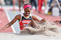 Ahhane Johnson of SE Missouri lands in the sand pit while competing in first round of triple jump during West Preliminary Track & Field Championships at John McDonnell Field, Friday, May 30, 2014 in Fayetteville, Ark. (Mo Khursheed/TFV Media via AP Images)