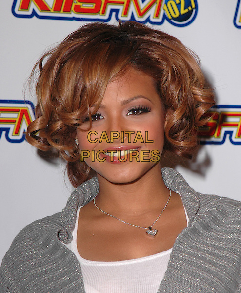 CHRISTINA MILIAN.102.7Õs KIIS-FMÕs 4th Annual Jingle Ball held at The Pond of Anaheim in Anaheim, California  .December 4th, 2004.headshot, portrait, curls, ringlets, heart necklace.www.capitalpictures.com.sales@capitalpictures.com.Supplied by Capital Pictures