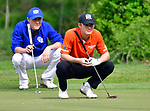 Clayton golfer David Cramer (left) and Webster Groves golfer Drew Schwager line up their putts at the 14th hole. Golfers in Suburban Central and Suburban XII Conference schools competed in a tournament at the Gateway National Golf Course in Madison, Illinois on Wednesday April 25, 2018.  Tim Vizer | Special to STLhighschoolsports.com