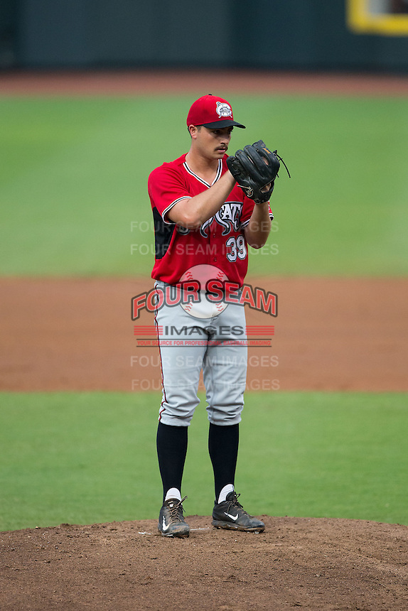 Carolina Mudcats starting pitcher Andrew Thurman (39) looks to his catcher for the sign against the Winston-Salem Dash at BB&T Ballpark on July 23, 2015 in Winston-Salem, North Carolina.  The Dash defeated the Mudcats 3-2.  (Brian Westerholt/Four Seam Images)