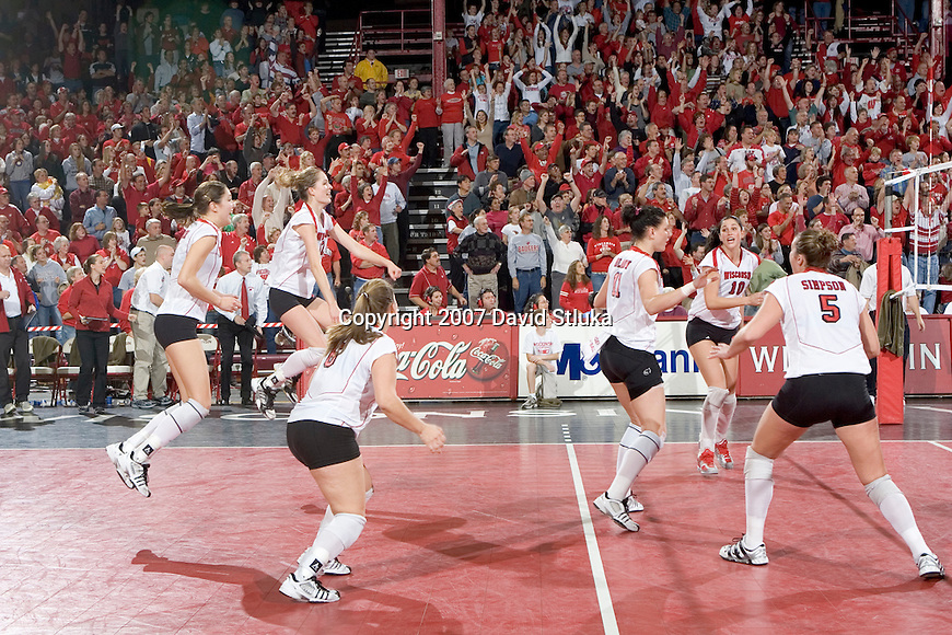 MADISON, WI - OCTOBER 27: The Wisconsin Badgers volleyball team celebrates against the Penn State Nittany Lions on October 27, 2006 in Madison, Wisconsin. (Photo by David Stluka)