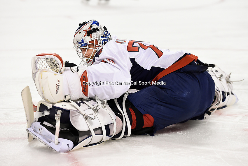 Tuesday, January 5, 2015:  Washington Capitals goalie Braden Holtby (70) warms up before the start of the National Hockey League game between the Washington Capitals and the Boston Bruins, held at TD Garden, in Boston, Massachusetts. Washington beats Boston 3-2 in regulation time. Eric Canha/CSM
