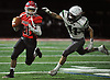 Joe Fabiano #21, Mineola quarterback, left, scrambles for yards as John DeRidder #11 of Carle Place-Wheatley closes in on him during a Nassau County Conference IV varsity football game at Hampton Stadium in Mineola on Friday, Oct. 13, 2017.