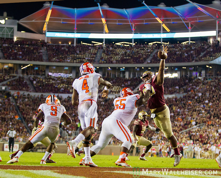 Florida State defensive lineman Demarcus Christmas blocks Clemson's  Deshaun Watson throwing from his end zone in the second half of an NCAA college football game in Tallahassee, Fla., Saturday, Oct. 29, 2016. Clemson defeated Florida State 37-34. (AP Photo/Mark Wallheiser)