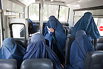 2 June 2013,  Jalalabad, Afghanistan.  Female students sitting in a bus waiting to be transported back to town at Nangarhar University in Jalalabad. Over 500 women attend the University and there has so far been no trouble from the Taliban regarding the education of women in Jalalabad.  Many of the facilities and equipment at the University are being provided under the World Bank funded Strengthening Higher Education Program (SHEP). The objective of the program is to restore basic operational performance at a group of core universities in Afghanistan. It aims to act as a catalyst to attract resources at Afghan tertiary education in the long term.  SHEP is the first major education investment in Afghanistan by the World Bank. In 2008 it received $US 5 million from ARTF to expand infrastructure and equipment to Universities in Kabul, Nangarhar , Balkh and Kandahar.  Picture by Graham Crouch/World Bank