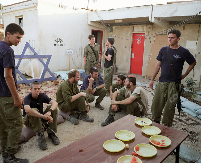 Israeli soldiers take a break at their military base in the Morag Settlement. The base is being dismantled as part of the Israeli pull out. Gaza, July 2005.