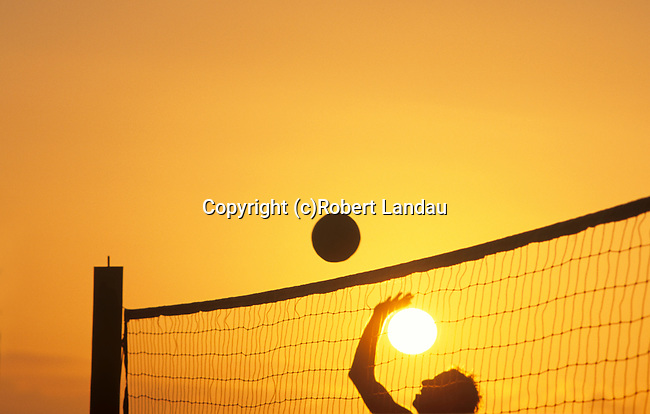 Beach Volleyball player at Santa Monica Beach with setting sun
