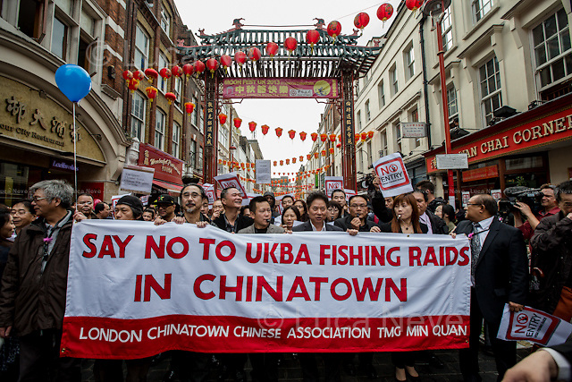 London, 22/10/2013. Today, hundreds of people gathered in Gerard Street, Chinatown, to protest against the recent immigration raids made by the UK Border Agency (UKBA). The day of action - which included strike, closure of restaurants, speeches and a demonstration in the streets of Chinatown - was organised by The London Chinatown Chinese Association (LCCA) and Min Quan supported by other activists organizations and citizens.<br />