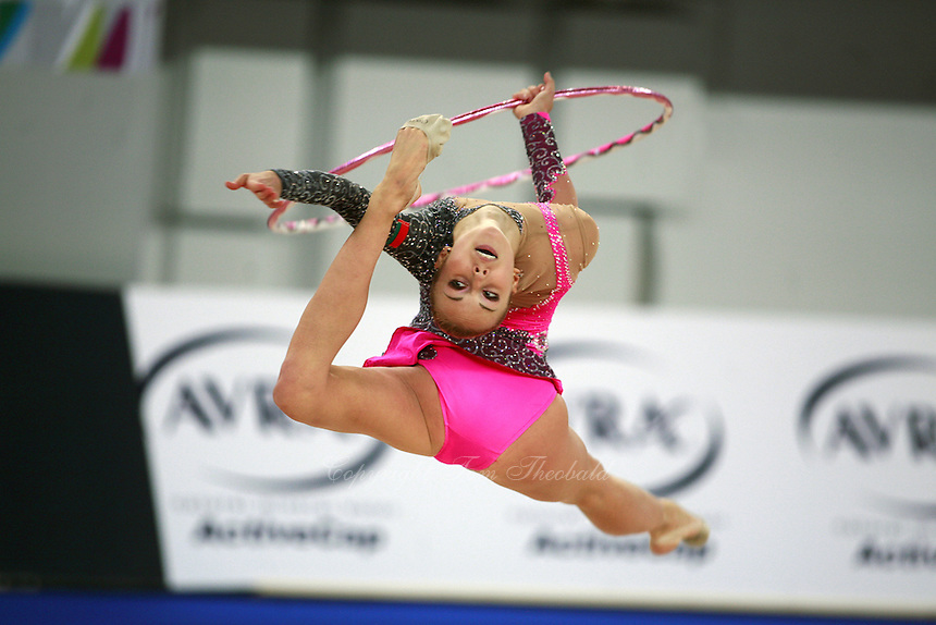 September 21, 2007; Patras, Greece;  Inna Zhukova of Belarus split leaps with hoop during the All-Around final at 2007 World Championships Patras.  Inna placed 4th in the AA to qualify Belarus for 1st of 2 positions in the individual All-Around competition at Beijing 2008 and the possibility of making her 2nd Olympic Games.  Photo by Tom Theobald. .