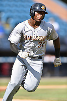 Charleston RiverDogs right fielder Jhalan Jackson (36) rounds the bases after hitting a home run during game one of a double header against the Asheville Tourists at McCormick Field on July 8, 2016 in Asheville, North Carolina. The RiverDogs defeated the Tourists 10-4 in game one. (Tony Farlow/Four Seam Images)