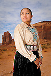 A portrait of a young native american woman in Monument Valley.