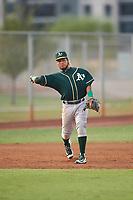 AZL Athletics Green third baseman Wilson Alvarez (3) throws to first base during an Arizona League game against the AZL Reds on July 21, 2019 at the Cincinnati Reds Spring Training Complex in Goodyear, Arizona. The AZL Reds defeated the AZL Athletics Green 8-6. (Zachary Lucy/Four Seam Images)