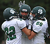 Kyle Dolan #9 of Lindenhurst, center, gets mobbed by teammates after making an interception in the fourth quarter of a Suffolk County Division I varsity football game against Northport at Glenn High School on Saturday, Sept. 2, 2017.