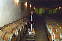"Madame Marie-Josée Pierre owner of Chateau Caillou in the barrel aging cellar pushing a ""shopping cart"" trolley with wine bottles at Chateau Caillou in Sauternes. Josee  Chateau Caillou, Grand Cru Classe, Barsac, Sauternes, Bordeaux, Aquitaine, Gironde, France, Europe"