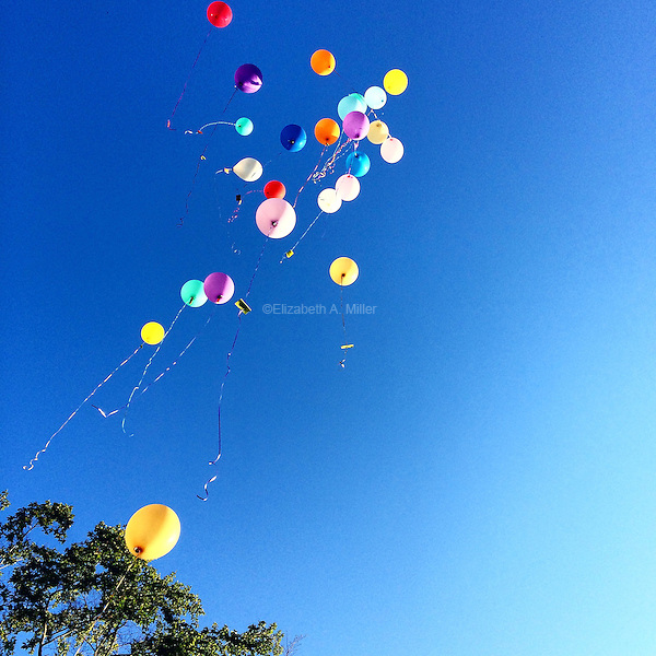 Balloons released over Baltimore, Maryland in memory of a deceased friend and family member.