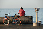 Man and bicycle at end of Stearn's Wharf