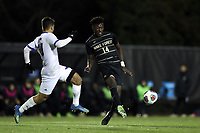 WINSTON-SALEM, NC - DECEMBER 07: Joey DeZart #14 of Wake Forest University plays the ball away from Rodney Michael #10 of the University of California Santa Barbara during a game between UC Santa Barbara and Wake Forest at W. Dennie Spry Stadium on December 07, 2019 in Winston-Salem, North Carolina.