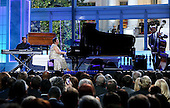 Herbie Hancock (L) and Aretha Franklin (C) perform at the International Jazz Day Concert on the South Lawn of the White House, in Washington, DC, April 29, 2016. United States President Barack Obama delivered remarks to introduce the event. <br /> Credit: Aude Guerrucci / Pool via CNP
