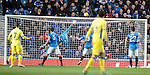 The ball arches over the outstretched glove of Wes Foderingham as S Johnstone take the lead