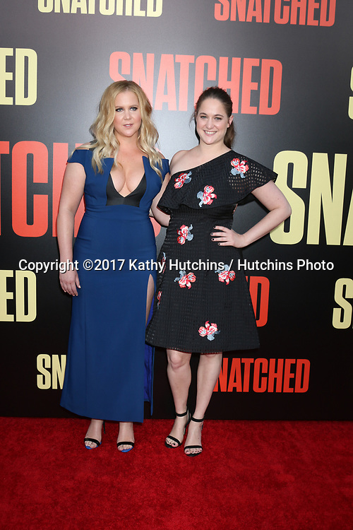 """LOS ANGELES - MAY 10:  Amy Schumer, Kim Caramele at the """"Snatched"""" World Premiere at the Village Theater on May 10, 2017 in Westwood, CA"""