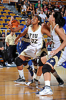 12 January 2012:  FIU guard-forward Tynia McKinzie (32) boxes out Middle Tennessee State guard Shanice Cason (5) in the first half as the Middle Tennessee State University Blue Raiders defeated the FIU Golden Panthers, 74-60, at the U.S. Century Bank Arena in Miami, Florida.