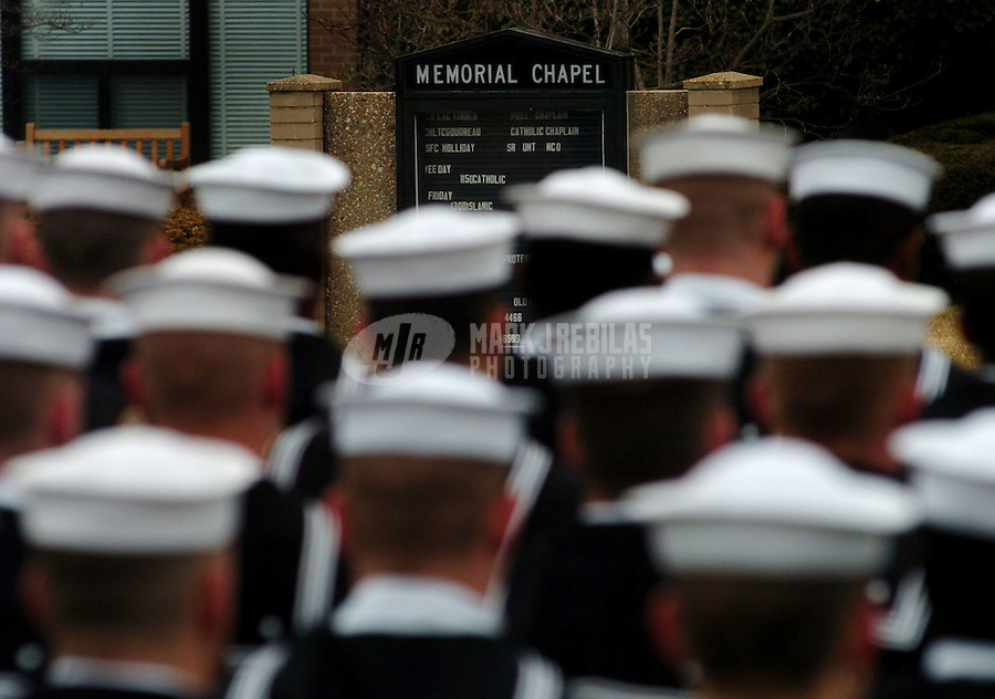 Arlington, Va. (Feb. 20, 2004) -- Members of the U.S. Navy Honor Guard stand in formation at the funeral of retired Admiral Thomas Moorer. Moorer had a distinguished naval career of 41 years from 1933 as a graduate of the Naval Academy to 1974 as the chairman of the Joint Chiefs of Staff. Moorer was chief of naval operations (CNO) from 1967 to 1970.   Photo by Mark J. Rebilas