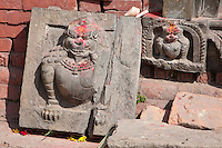 Kathmandu, Nepal.  Snow Leopards Carved in Stone inside a Neglected Neighborhood Hindu temple.