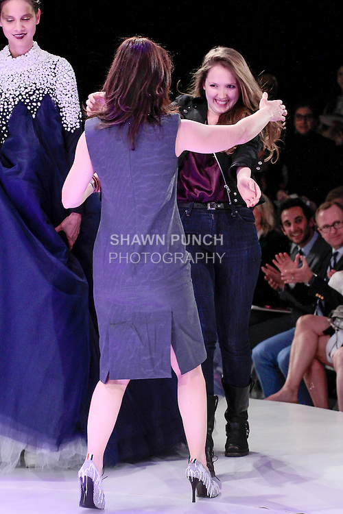 Graduating fashion student Madeline Gruen, wins the Liz Claiborne Award at the 2013 Pratt Institute Fashion Show, on April 25, 2013.