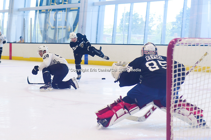 June 29, 2018: Boston Bruins forward Jack Becker (72) takes a shot at Boston Bruins goalie Kyle Kyser (85) during a scrimmage at the Boston Bruins development camp held at Warrior Ice Arena in Brighton Mass. Eric Canha/CSM