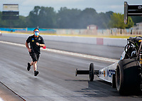 Jul 10, 2020; Clermont, Indiana, USA; Crew members for NHRA top fuel driver Leah Pruett during testing for the Lucas Oil Nationals at Lucas Oil Raceway. This will be the first race back for NHRA since the COVID-19 pandemic. Mandatory Credit: Mark J. Rebilas-USA TODAY Sports