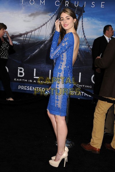 "Dominik Garcia-Lorido.""Oblivion"" Los Angeles Premiere held at the Dolby Theatre, Hollywood, California, USA..April 10th, 2013.full length blue dress lace backless hand arm side beige shoes .CAP/ADM/BP.©Byron Purvis/AdMedia/Capital Pictures."
